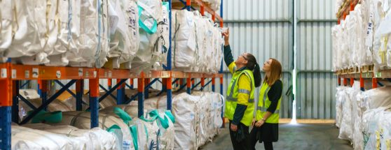 Two Sadleirs employees discussing bulk bags in packaging warehouse