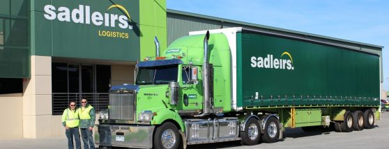 father & son next to a Sadleirs truck in Melbourne depot