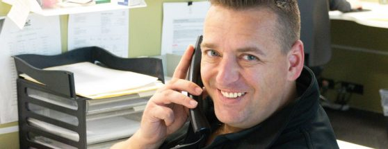 Sadleirs employee answering phone with friendly expression